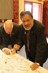 Pita Sharples and White Ribbon Ambassador Barry Mathews sign