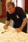 White Ribbon Committie Chair Brian Gardner signs