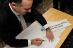Prime Minister John Key Signs the White Ribbon Pledge before becoming a White Ribbon Ambassador