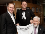 Prime Minister John Key, White Ribbon Coordinator Rob McCann and Chief Executive Families Commission Paul Curry with the White Ribbon Pledge